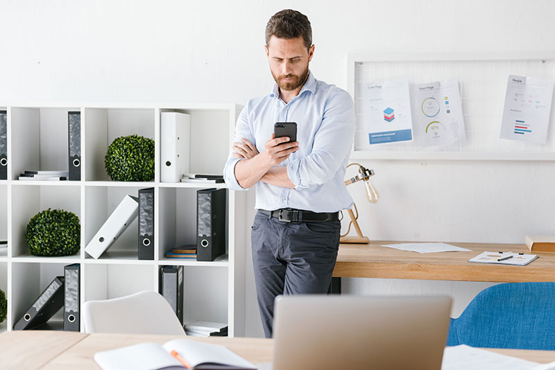 Man working from phone