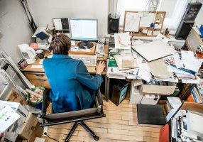 High Angle View Of Office Worker Working On Computer
