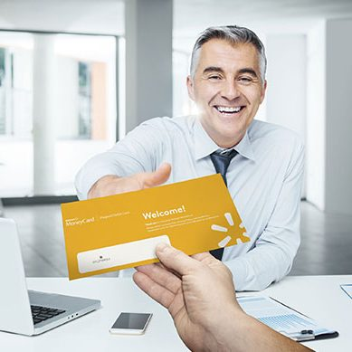 man-handing-card-to-client